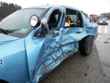 Maine State Police Trooper William Baker suffered bumps and bruises when his cruiser was struck on the Maine Turnpike in York on Sunday. The cruiser was destroyed.