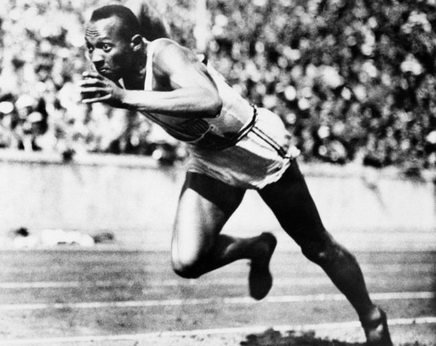 In this Aug. 14, 1936, file photo, Jesse Owens competes in one of the heats of the 200-meter run at the 1936 Olympic Games in Berlin.