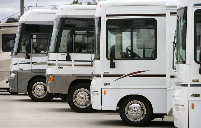 Winnebago motor homes are shown on a lot in Jefferson, Iowa. Led by sales growth for towable RVs and pricier stand-alone motor homes, recreational vehicle makers expect to ship more than 300,000 units to dealers in 2013 for the first time since the economic downturn.