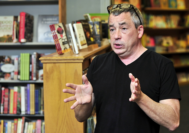 Chris Bowe, co-owner of Longfellow Books in Portland, says Maine's government needs the millions of dollars in sales taxes that many online retailers still don't have to collect.