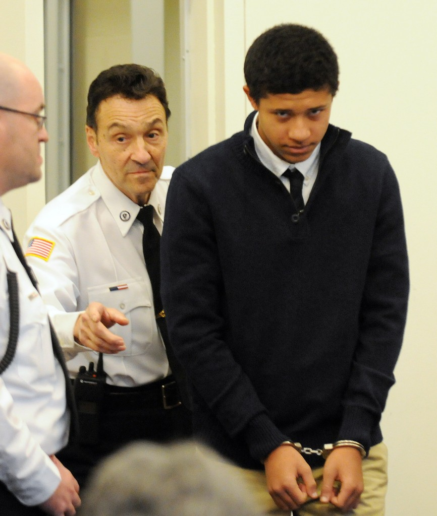 Phillip Chism, 14, is lead into Salem Superior Court on Wednesday in Salem, Mass. He is charged in the Oct. 22 killing of Colleen Ritzer, a Danvers High School teacher.