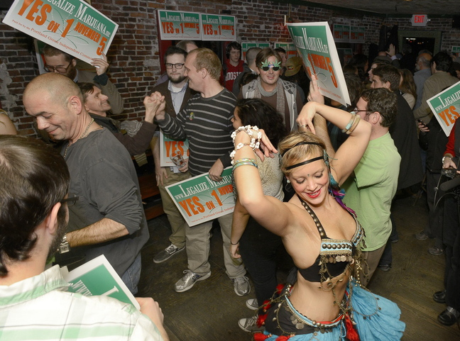"""Belly dancer Whitley """"Nabintu"""" Marshall dances as proponents of Portland's Yes on One celebrate at Brian Boru in Portland on Nov. 5. Police, city officials and proponents of legalization want to clarify the ordinance."""