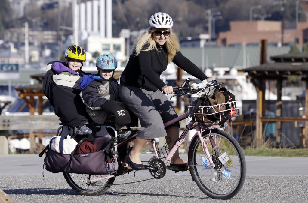 People in the Pacific Northwest are pushing the limits of what they can carry using so-called cargo bikes, shuttling children, groceries, fish and kegs of beer. AP Photo