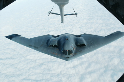 A B-2 Spirit stealth bomber approaches an Air Force KC-10(A) tanker plane over Missouri to receive an aerial refueling after taking off from Whiteman Air Force Base in Missouri in 2002 .