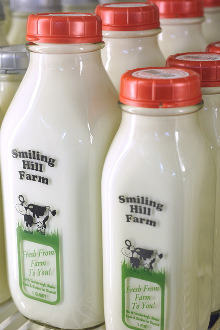 Bottles of milk are lined up at Smiling Hill Farm in Westbrook on Thursday. The dairy version of a fiscal cliff looms, industry and economic experts say.