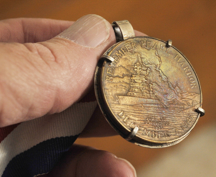 A medal commemorating the Pearl Harbor attack on Dec. 7, 1941 belonged to Bert Davis.