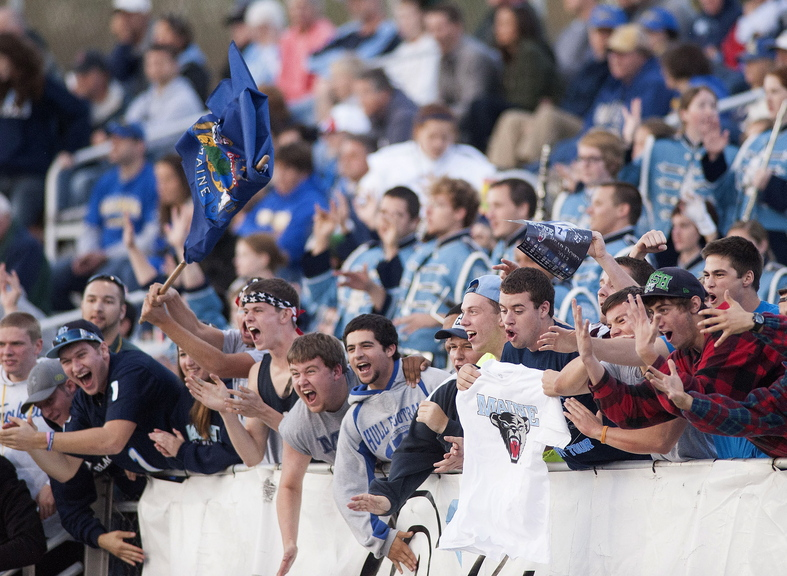 Maine fans celebrate in the second half of an NCAA football game against Delaware in Orono on Oct. 5. In this year's five regular-season home games, all victories, Maine drew an average crowd of 5,533.