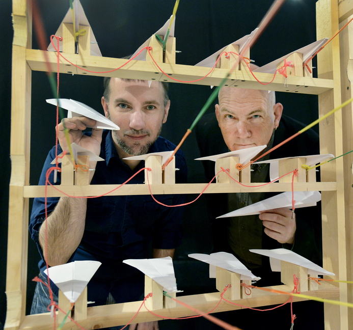 Fritz Grobe, left, and Stephen Voltz devise new DIY projects like this one called Paper Airplane Squadron in their Buckfield Grange Hall laboratory.