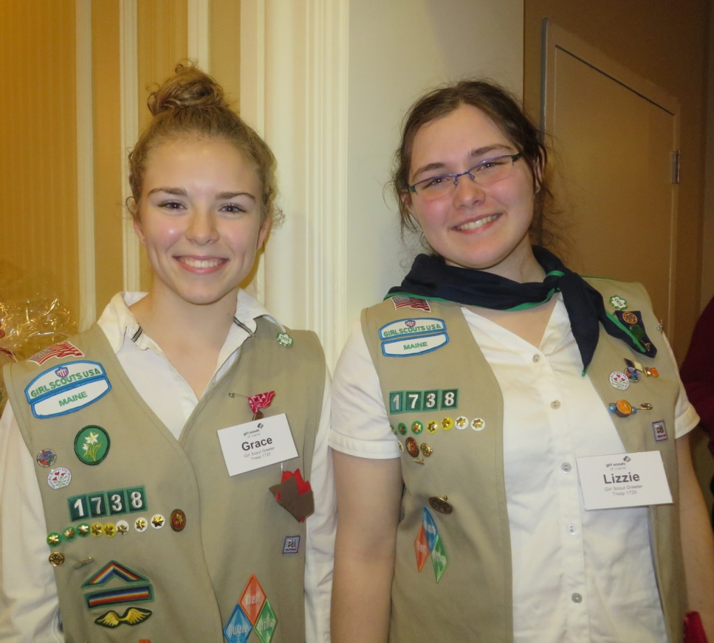 High school juniors Grace Conant of Westbrook and Lizzie Kane of Gorham show their Girl Scout colors.