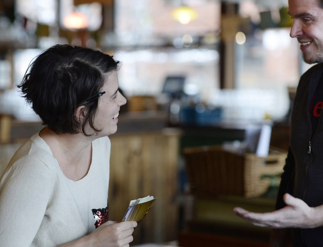 """Server Emily Young talks with big tipper Seth Collins after he surprised her with a $500 gratuity on a $43.90 bill Monday at Flatbread Company in Portland. """"I feel very lucky,"""" said Young, 30."""