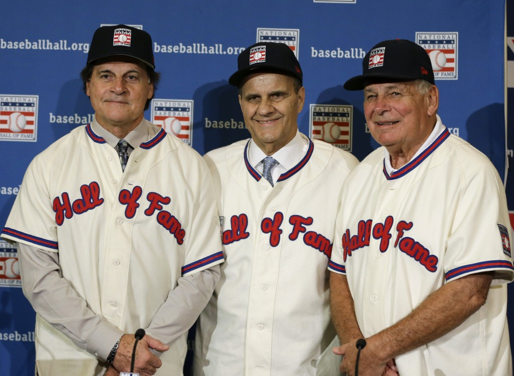 Retired managers, from left, Tony La Russa, Joe Torre and Bobby Cox gather for a photo after it was announced that they were unanimously elected to the baseball Hall of Fame, at a news conference during MLB winter meetings in Lake Buena Vista, Fla., Monday, Dec. 9, 2013.