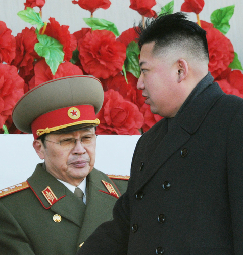 """In this Feb. 16, 2012 photo, North Korean leader Kim Jong Un walks past his uncle Jang Song Thaek, left, after reviewing a parade of thousands of soldiers and commemorating the 70th birthday of the late Kim Jong Il in Pyongyang, North Korea. North Korea announced Monday, Dec. 9, 2013 it had sacked leader Jang, long considered the country's No. 2 power, saying corruption, drug use, gambling, womanizing and generally leading a """"dissolute and depraved life"""" had caused Pyongyang's highest-profile fall from grace since Kim took power two years ago."""