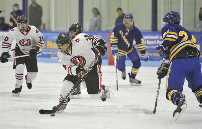 Scarborough's Matt Caron races the puck into the Falmouth zone during a 2-0 win by the Red Storm on Monday at the Alfond Forum in Biddeford. Scarborough was looking for a measure of revenge after losing to Falmouth, 4-3, in the state tournament last year. ––