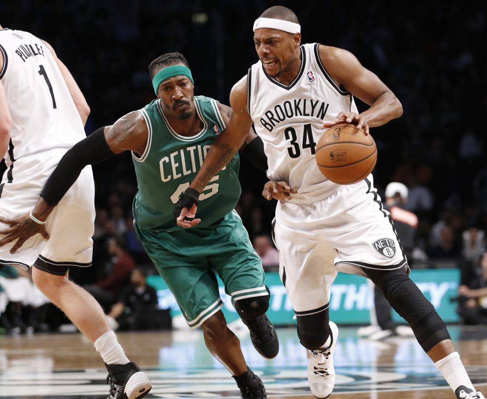 Paul Pierce looked a whole lot different Tuesday night, wearing a Brooklyn Nets uniform, coming off the bench and finishing with four points. But Brooklyn did beat the Celtics.