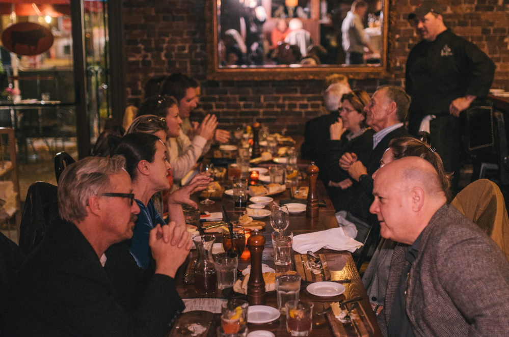 Chef Harding Lee Smith, back right, chats with participants in a tour of his restaurants offered by Portland Taste Tours.