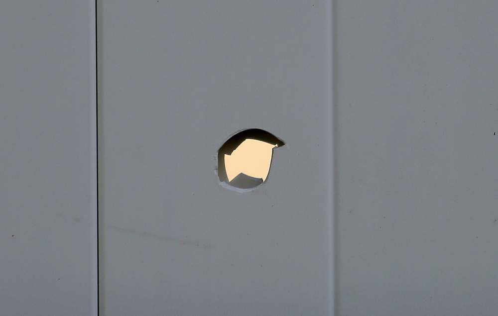 A bullethole in Toni Macquinn's backyard fence in Old Orchard Beach.