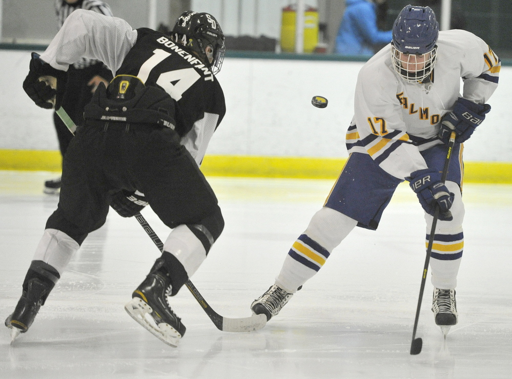 St. Dominic's Bryan Bonenfant, left, and Falmouth's Brandon Peters have been told to keep their sticks on the ice, but that's not where the puck is during Thursday night's game at Family Ice Center.