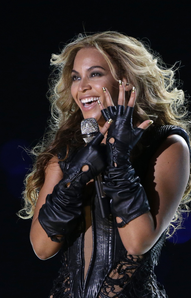 """Beyonce released her fifth self-titled album on iTunes early Friday without announcing it previously. The """"visual album"""" features 14 songs and 17 videos."""