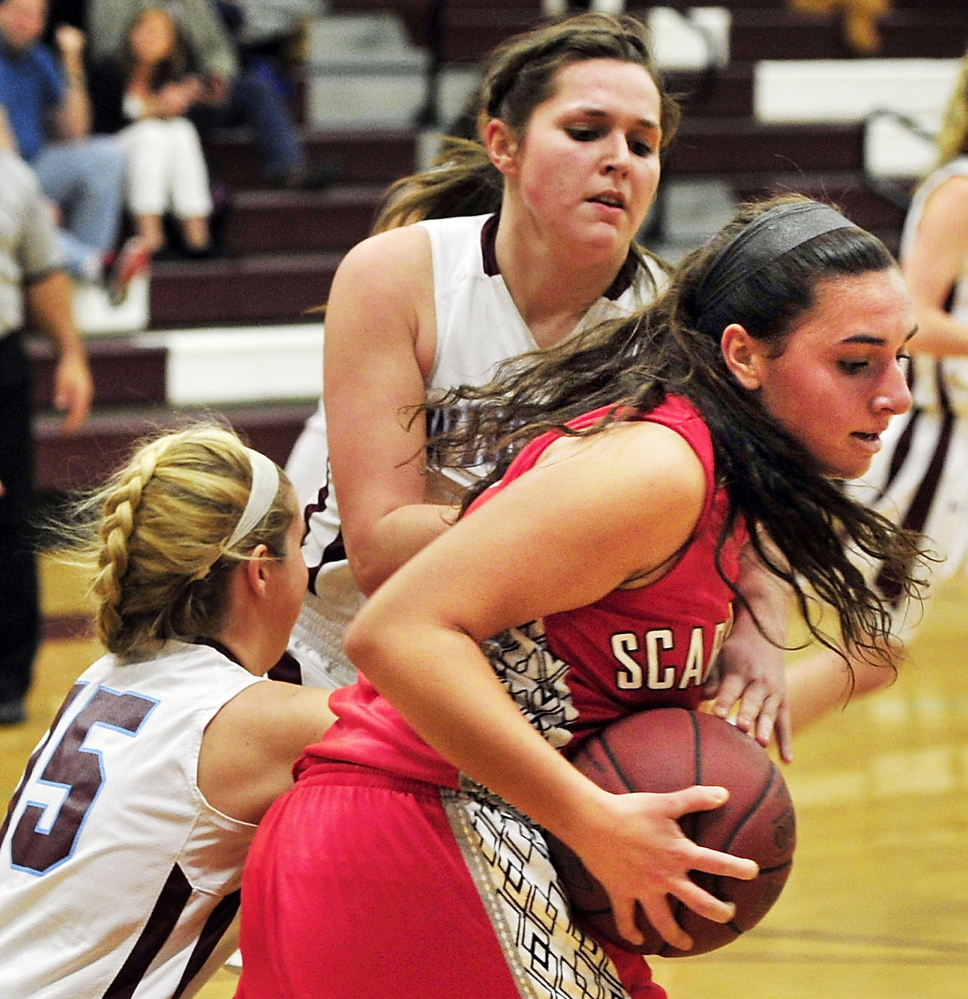 Emma Hall of Scarborough pulls down a rebound in front of Windham's Macy Mannette, left, and Haley Batchelder. Windham handed the Red Storm their first loss.
