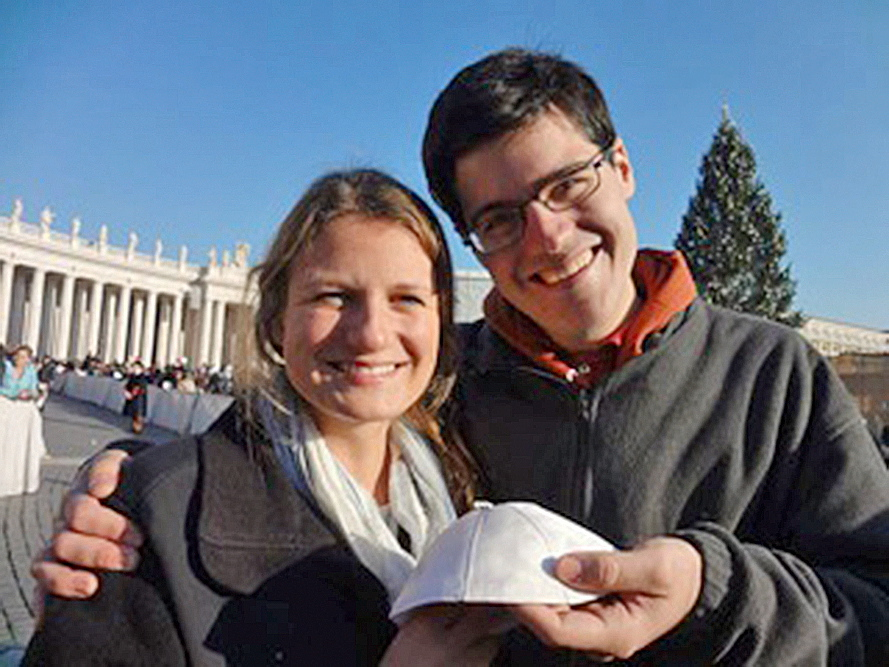 Boston College students Katherine Rich and Ethan Mack of Portland hold the pope's skullcap they received in Rome.