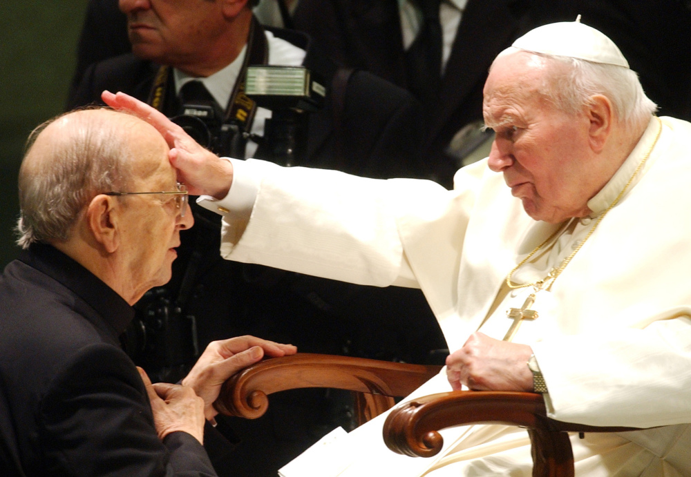 Pope John Paul II gives his blessing to the Rev. Marcial Maciel, founder of Christ's Legionaries, during a special audience the pontiff granted Nov. 30, 2004.