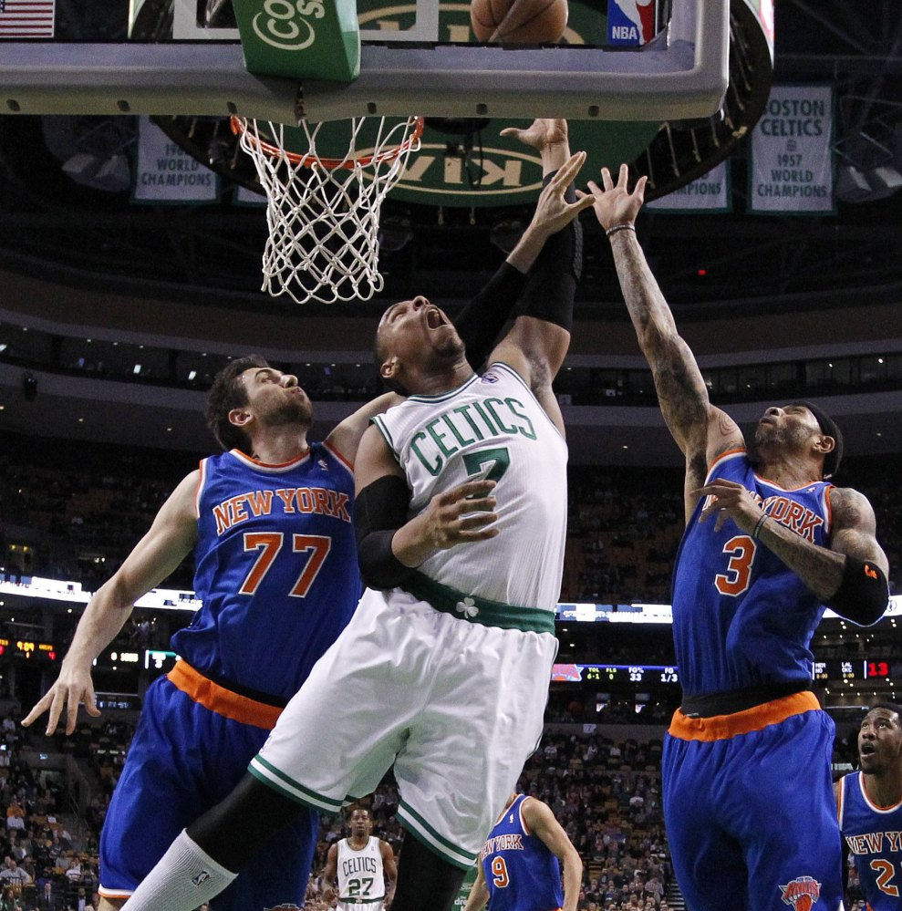 Boston's Jared Sullinger battles New York's Andrea Bargnani, left, and Kenyon Martin for a rebound in the first quarter of Friday's game in Boston.