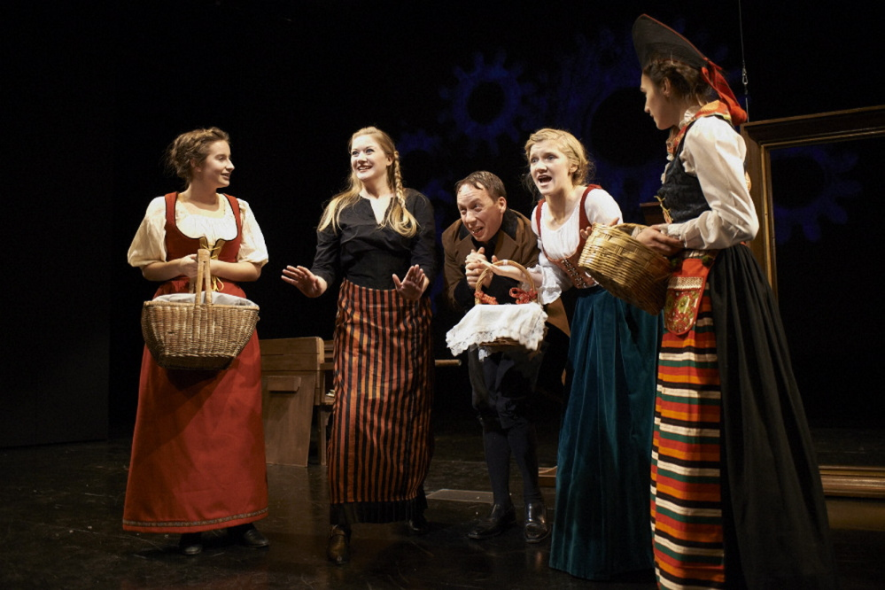 Villagers exclaim over the first snowfall in a scene from the Portland Stage Company production of the Hans Christian Andersen fairytale