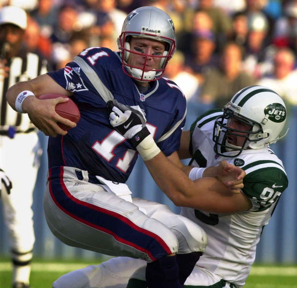 New England Patriots quarterback Drew Bledsoe (11) is sacked by New York Jets defensive end Rick Lyle (95) during first half of NFL action at Foxboro Stadium in Foxboro, Mass. on Oct. 15, 2000.