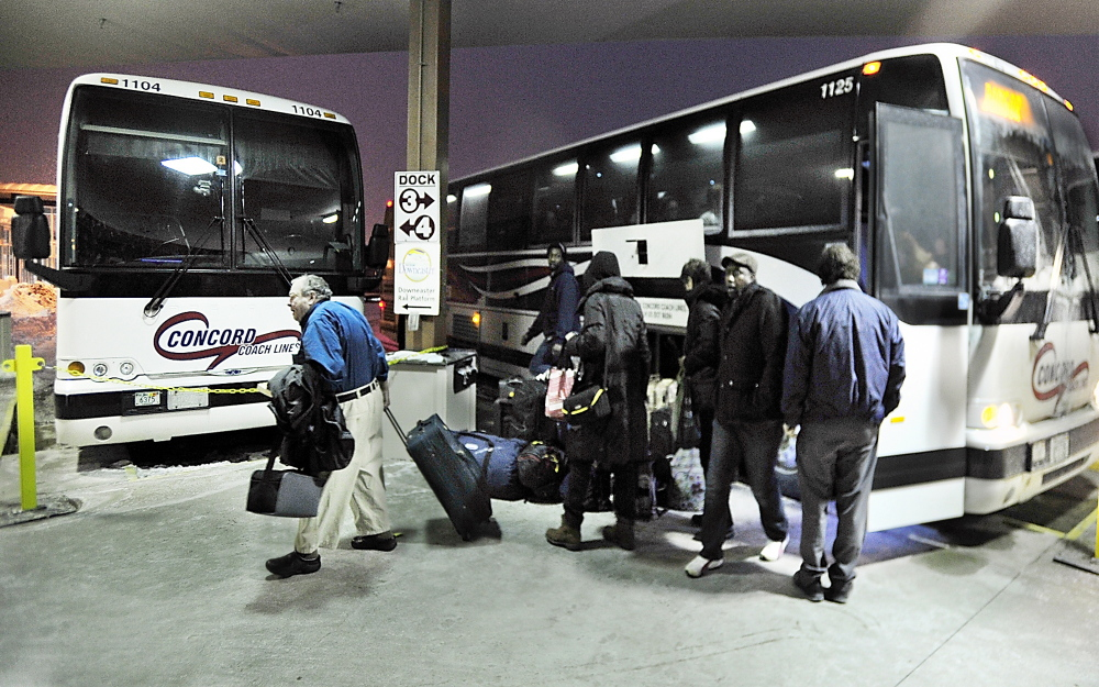 Passengers exit a Concord Coach Lines bus arriving Monday at the Portland Transportation Center. The bus line is looking into starting service from Auburn to Boston with a stop in Wells.