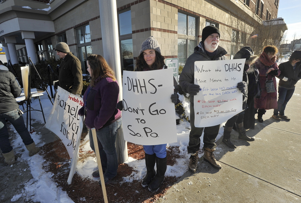 "Demonstrators gather Tuesday outside the Department of Health and Human Services office on Marginal Way in Portland to protest the state's relocation plan. ""The trip to South Portland is long, even by bus,"" said protester Jim Devine."