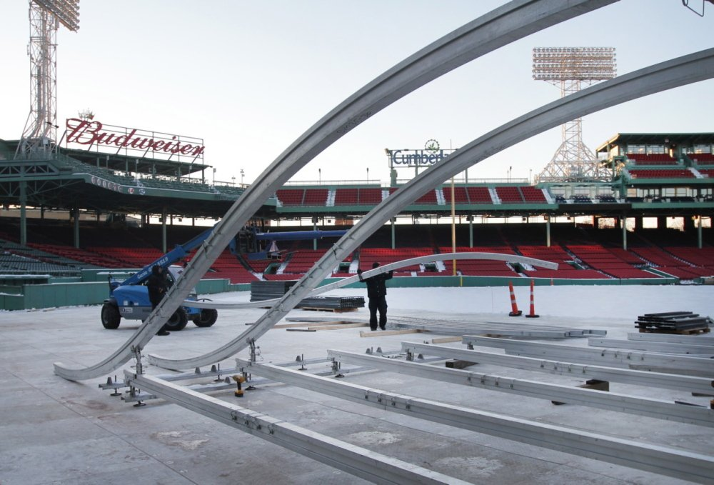 """A crew sets up the """"Monster Sled,"""" created by StackBox Structures LLC of Portland, on Tuesday at Fenway Park."""