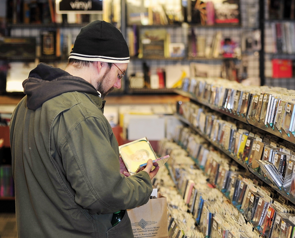 """Brady Alden of Gray shops for CDs at Bull Moose in Portland. He likes to wander into local stores, he said, because """"I think you find better stuff – things you weren't even looking for that catch your eye."""""""