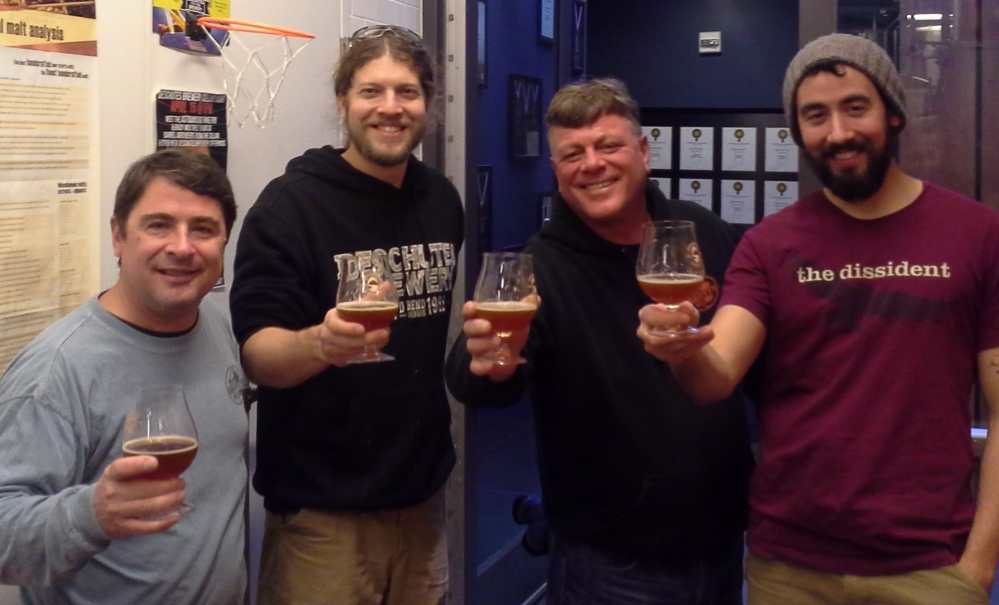 From left, Bill Stebbins, assistant brewer at Gritty McDuff's; Ben Kehs, head brewer at Deschutes Brewing Company in Portland, Ore.; Ed Stebbins, brewmaster at Gritty's; and Jason Barbee, assistant brewer at Deschutes, during a recent visit by the Gritty's team to the Deschutes facility.