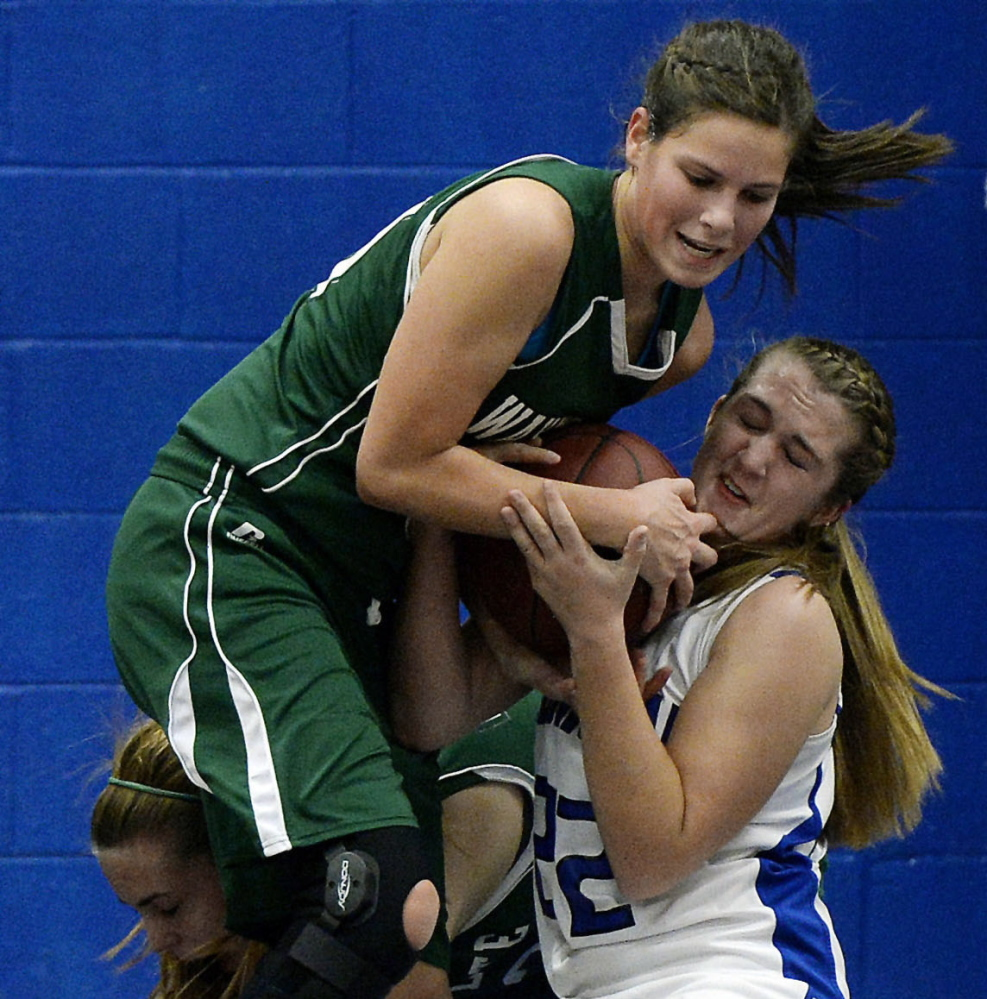 Juliana Harwood, left, of Waynflete and Lauralee Small of Old Orchard Beach battle for the ball during Waynflete's 46-44 win Thursday night.