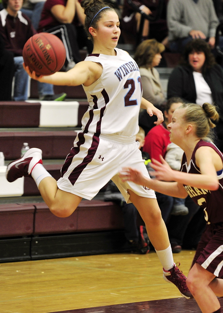 Luisa Sbardella of Windham reaches out to stop the ball from going out of bounds as Gorham's Kaylea Lundin defends.