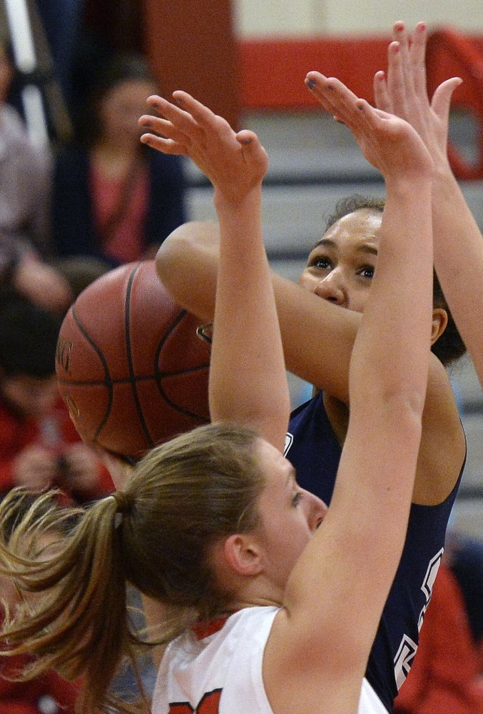 Gabrielle Wagabaza of Portland drives to the basket against South Portland's MacKenzie Bowring during their SMAA basketball game Friday night. Portland won, 50-46.