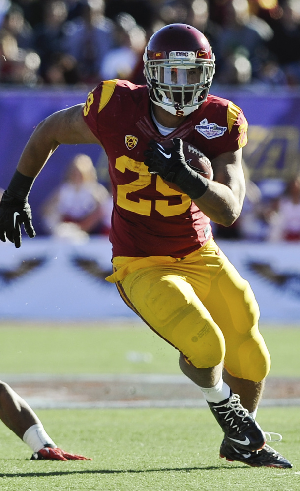 Ty Isaac of Southern Cal runs Saturday afternoon during the Trojans' 45-20 victory against Fresno State in the Las Vegas Bowl.