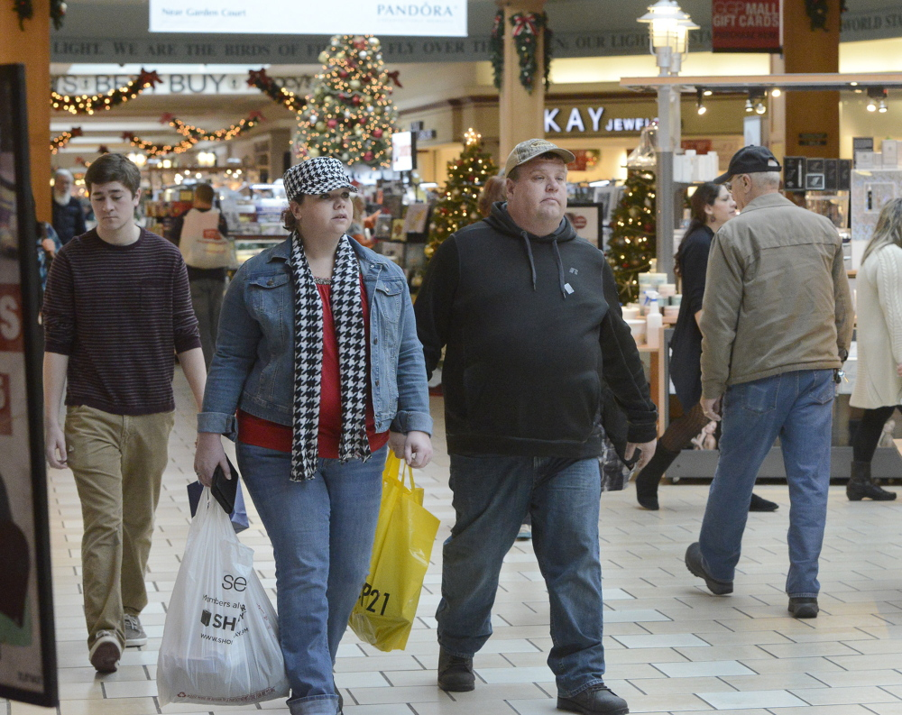 Darcie and Eddie Raymond from Corinth join the throng of shoppers at the Maine Mall on Saturday.