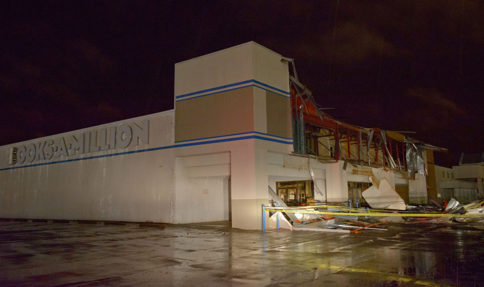 The Books-A-Million store is seen damaged by heavy wind and rain during a major storm in Monroe, La., Saturday, Dec. 21, 2013.
