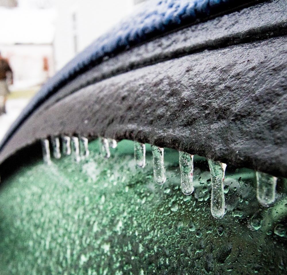 Ice builds up from Sunday's rain on Mark Storck's car in his Bridgton driveway. More icing is expected Monday morning with freezing rain forecast to linger until the afternoon.
