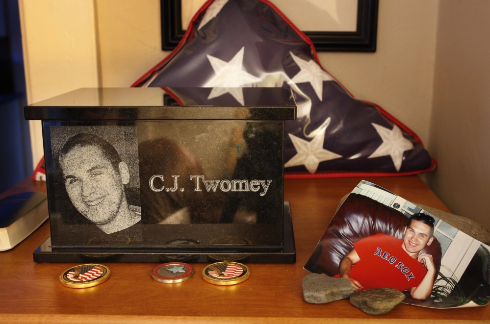 An urn containing the ashes of C.J. Twomey is surrounded by mementos at his parents' home in Auburn.