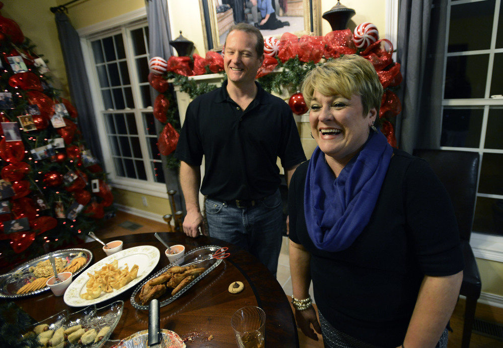 Dr. Jason Cabler and his wife, Angie, get ready for a holiday party at their home in Hendersonville, Tenn. Cabler, 46, suffered a heart attack on Christmas Day in 2012 while lifting weights in the exercise room in their home. Studies indicate heart troubles, including fatal heart attacks, spike this time of year, especially on Christmas and New Year's.
