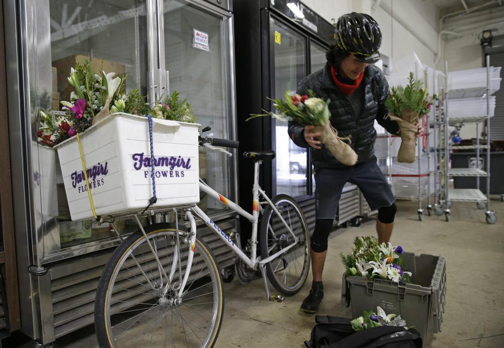 Ian Kizu-Blair, with Farmgirl Flowers, drops off a shipment to the Good Eggs warehouse in San Francisco.