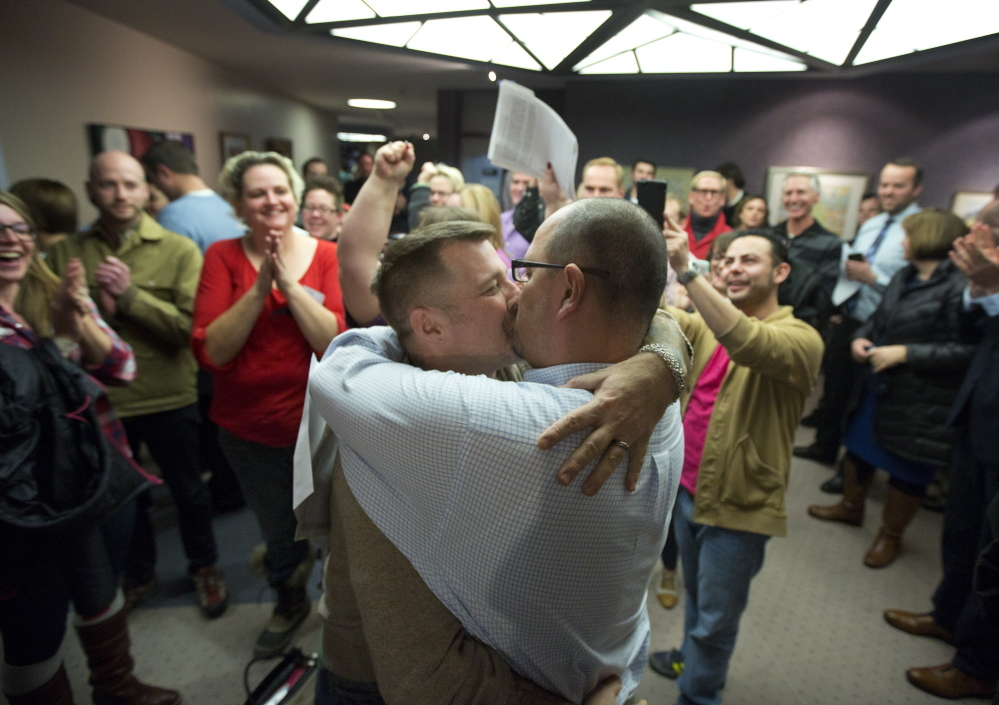 Chris Serrano, left, and Clifton Webb kiss after being married in Salt Lake City last Friday. Judges in Utah, New Mexico and Ohio have all ruled in favor of gay marriage recently.