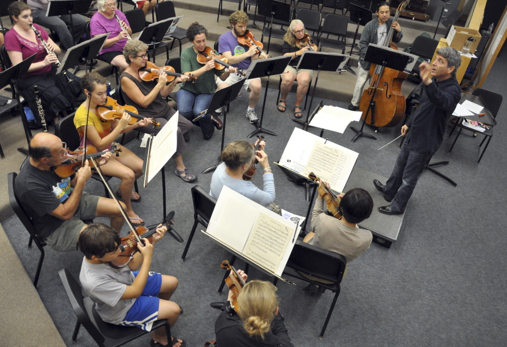 "In this Sept 12, 2013 photo, provided by Me2/Orchestra, Ronald Braunstein conducts a rehearsal of the orchestra in South Burlington, Vt. Bipolar disorder slowed what might have been an explosive career for Braunstein. With his wife, French horn player Caroline Whiddon, Braunstein now runs the Me2/Orchestra, billed as ""the world's only classical music organization for individuals with mental illness and the people who support them."" (AP Photo/Me2/Orchestra, John Siddle)"