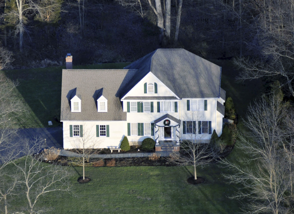 This photo released by Connecticut State Police on Friday, Dec. 27, 2013 shows an aerial view of the home where Adam Lanza lived with his mother in Newtown, Conn. Lanza gunned down 20 first-graders and six educators with a semi-automatic rifle at Sandy Hook Elementary School on Dec. 14, 2012, in Newtown, after killing his mother inside their home. Lanza committed suicide with a handgun as police arrived at the school. (AP Photo/Connecticut State Police)
