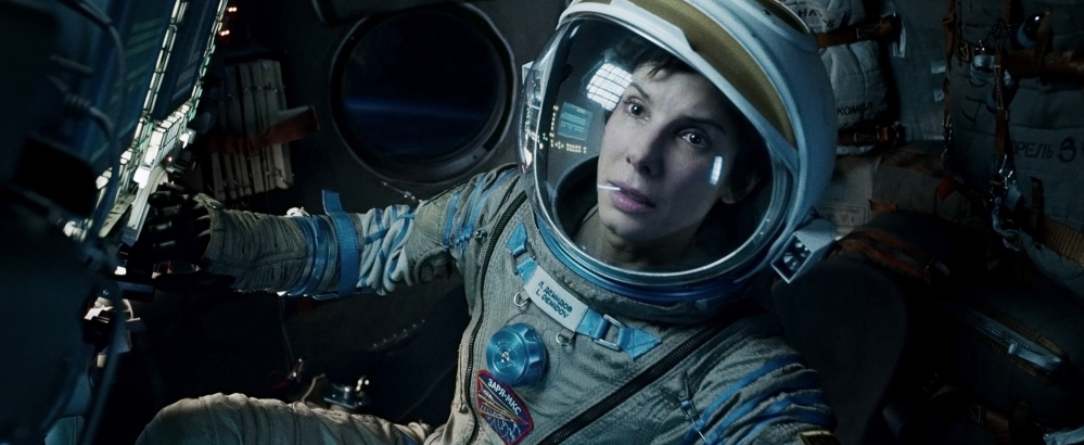 """Sandra Bullock stars in """"Gravity,"""" the Warner Bros. space epic that has earned $254 million domestically so far. A strong holiday slate – """"The Hobbit,"""" """"Nebraska,"""" """"Dallas Buyers Club"""" and """"Mandela"""" – is also boosting the year's box-office total."""