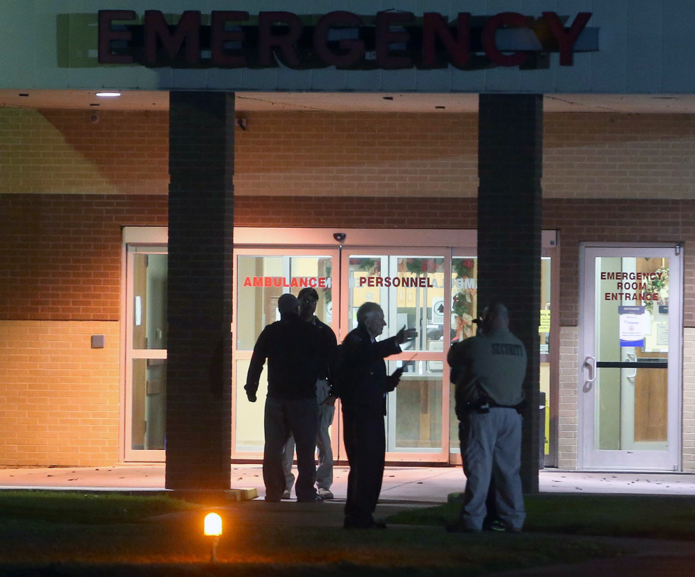 Security personnel stand outside Ochsner St. Anne Hospital in Raceland, La., one of three hospitals placed on lockdown after Ben Freeman went on a shooting rampage in four locations in two parishes in south Louisiana on Thursday.