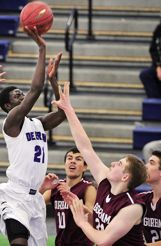 Ahmed Ismail Ahmed of Deering gets his shot off over the Gorham defense Friday night during Deering's 77-51 victory at the Portland Expo – a regular-season game in a holiday tournament.