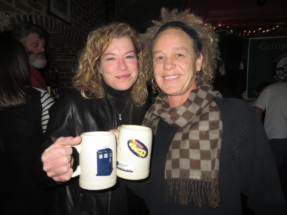 Gritty's Mug Club members Tina Deschaine and Kristin Espey, both of Portland, feel at home at Gritty's.
